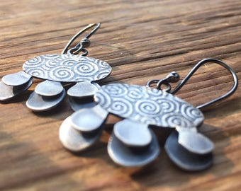 Spiral patterned ovals with Sterling petals,