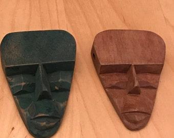 Vintage 1960's hand carved wood mask pendant.