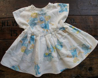 Doll Dress ~ Vintage ~ Handmade Doll Clothes ~ White With Toy/Doll Print & Blue Buttons