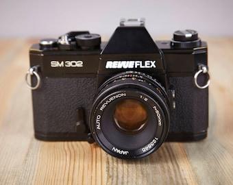 Film Camera Revueflex SM 302. SLR camera. Cosina Camera. Vintage Camera Revueflex. Lens 50mm.