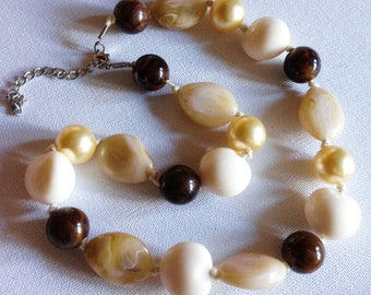 Necklace - pretty marbled plastic beaded necklace brown and cream pearly amber pebble shaped beads