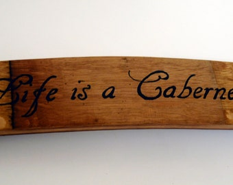 Life is a Cabernet sign on a repurposed wine barrel stave