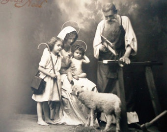 Antique Christmas postcard - Nativity baby Jesus, girl child staff, Mary halo sheep, Joseph carpenter, french sepia 1910