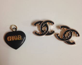 Two buttons and 1 charm Chanel