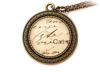 Necklace, chain made from a 1890-1940 postcard, brass and glass cabochon - Old writing
