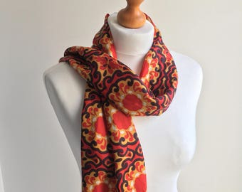 Vintage 1960s or 70s long acetate scarf in red, ochre and black