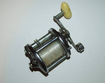 Vintage Penn No. 9 Peerless Fishing Reel with Bakelite sides.