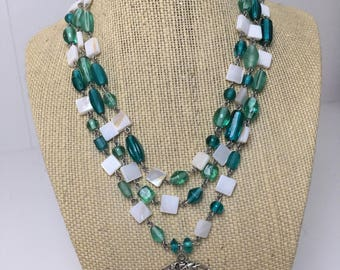 Multiple strand necklace with sea pendant