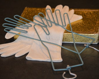 Mesh Gloves on Metal Glove Forms