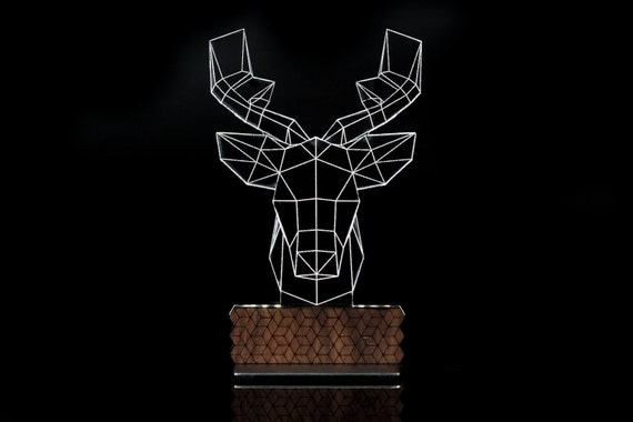 dEEr 3D Illusion table lamp designed by Zinteh. Contemporary
