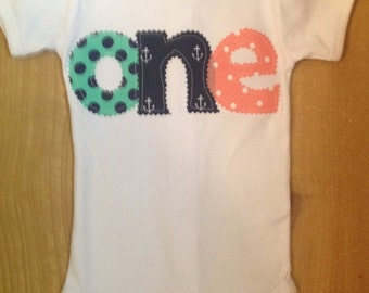"Aqua, Navy, and Coral Nautical Anchors and Polka Dots 1st Birthday ""One"" Shirt or Baby Bodysuit"
