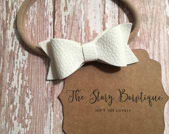 Faux leather bow with band