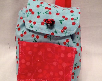 """18"""" doll backpack: Fun red cherries on blue fabric with a drawstring closure and velcro flap"""