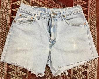 vintage Levis cut-offs, medium/mid-rise light denim jean shorts with raw hem, small/medium size 30