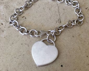 Lovely Sterling silver hanging heart charm bracelet.