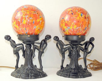 Pair of French Art Deco spelter figural table lamps with orange Czechoslovakian globe c. 1940