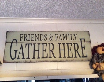 friends and family gather here  sign