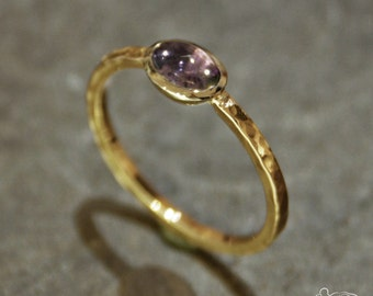 Yellow gold ring and white gold setting with amethyst