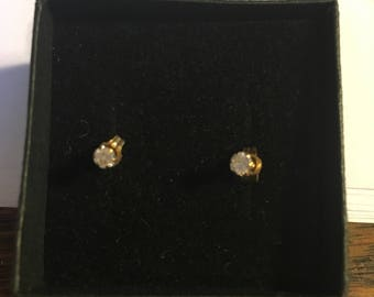 Tiny CZ solitaire stud earrings in 9ct gold claw setting
