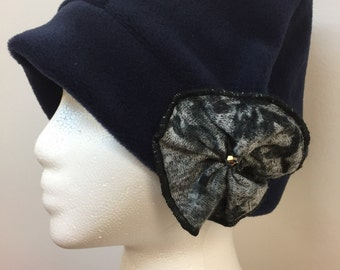 Navy blue fleece hat with patterned flower