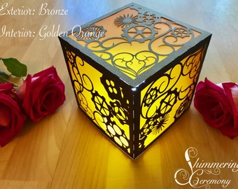 Steampunk laser cut paper luminary lantern table centerpiece gears and hearts lighting wedding themed party decor