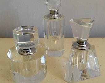 A Trio of Three Vintage Cut Glass/Crystal Perfume/Scent Bottles. Signed. Oleg Cassini. Ornamental Bottles and Stoppers.
