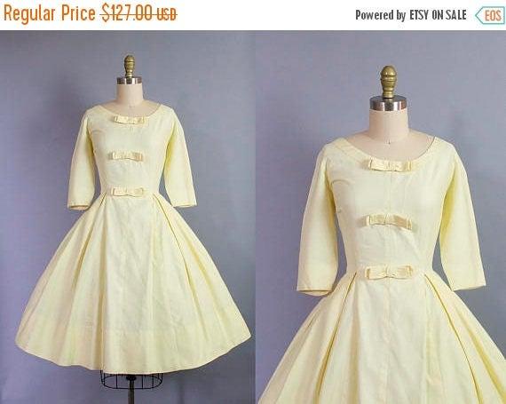 SALE 15% STOREWIDE 1950s yellow day dress/ 50s cotton pique dress w/ bows/ medium