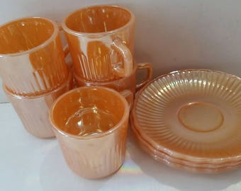 A set of Fire King peach lustreware  cups and saucers by anchor hocking made in usa