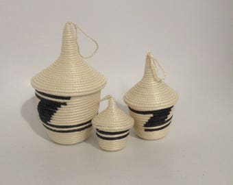 All of the baskets/vases with lids to ethnic patterns, hand-woven