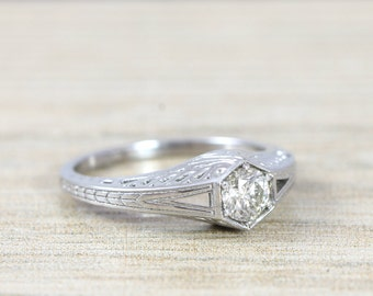 Diamond solitaire engagement ring handmade in 14 carat white gold art nouveau inspired