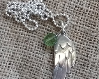 Angel wing with green glass nugget