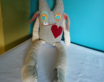 Small grey horney stuffed monster toy