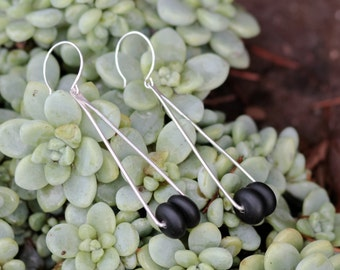 Long Triangular Earrings with Black Sea Glass