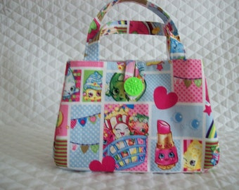 "Shopkins Little girls Handbag,7"" x 5"" x 2"",with button to close.This handbag has a white liner.also in the Christmas shopkins print"