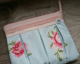 Cosmetic bag in pink/blue with lace trim