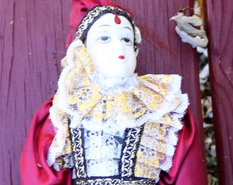 Vintage Porceline Doll with Beautiful Burgandy Outfit