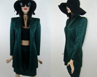 ESCADA by Margaretha Ley dark green suit with cheetah print. Mid length pencil skirt and mid length blazer, size given 38/M/10