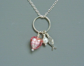 Sterling Silver Fish Pendant Necklace With A Single Freshwater Pearl And A Pink Silver Lined Murano Heart