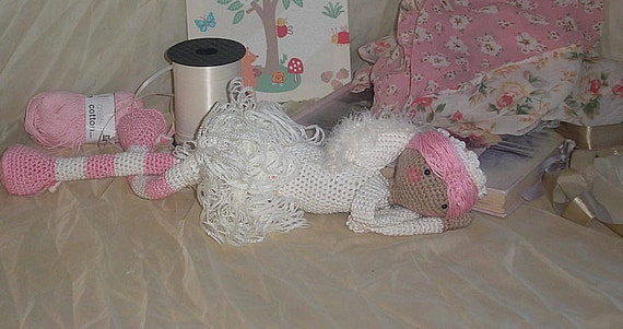 Angel Snuggle Doll, Handmade in Pink and Cream cotton yarn, detailed with angel wings and lace skirt, floppy arms and legs to cuddle