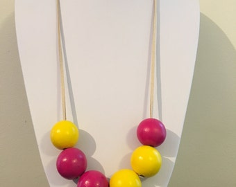 Hand-painted bright asymmetrical necklace in yellow and pink