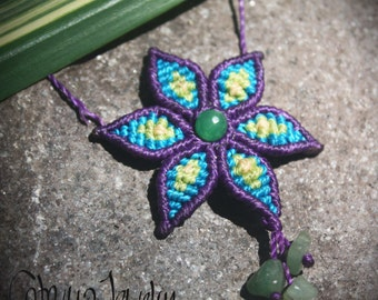 Handmade macrame flower necklace. Purple, blue, yellow and green. Made with waxed poliester cord.