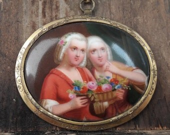 Victorian pendant with hand painted miniature porcelain painting of two young ladies