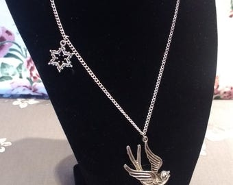 Handmade Vintage Style Silver Swallow Necklace With A Silver Star on The Side Of The Swallow.