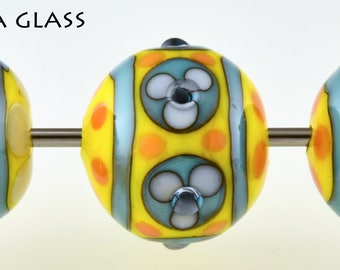 Three pretty floral lamp work glass beads