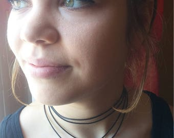 Long necklace cord of brown leather with Gold Medallion