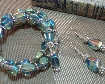 Translucent blue memory wire bracelet w/matching earrings.