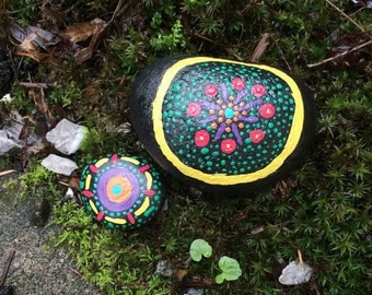 Two colorful painted rocks-