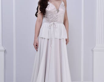 Silky wedding dress, with added belt, open back and lace top.