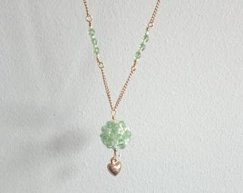 Green/white ball necklace with gold chain