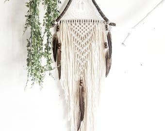 Wooden triangle macramé dreamcatcher, made from organic materials and natural forrest feathers
